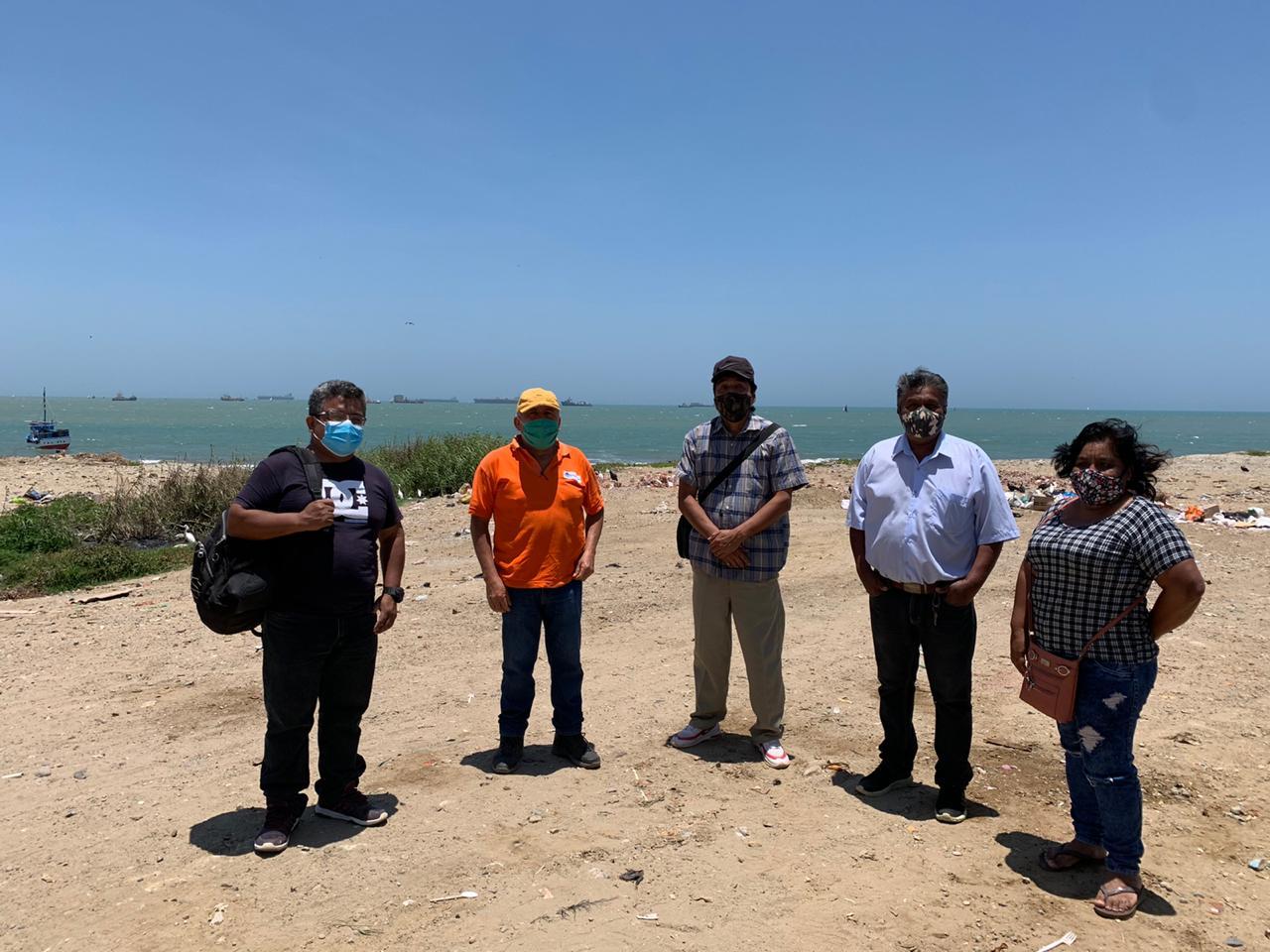 Alipio Martinez y Juan Guevara comentan sobre la situación en San Pedro.